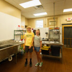 Owners son and friend in the new commercial kitchen