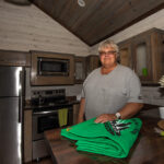 Randy Isaacson in their new cabin at jellystone