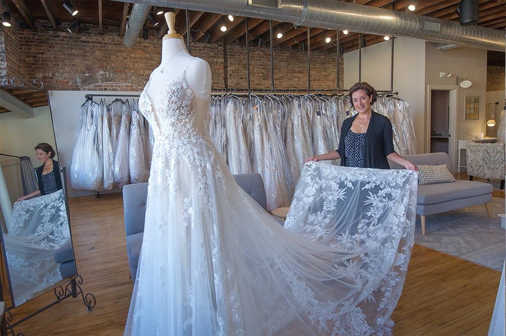 Wendy Lynch Holding Wedding Dress