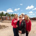 isaacson family in front of new cabins